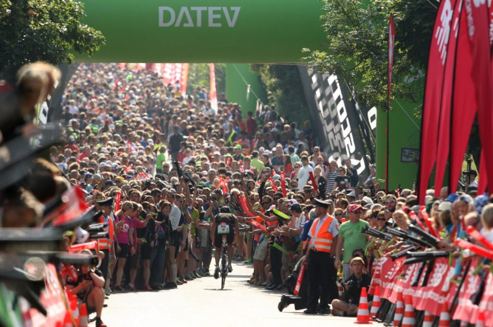 ROTH, GERMANY - JULY 14: Crowds congregate on Solar Hill on the bike stage during the Challenge Roth Triathlon on July 14, 2013 in Roth, Germany. (Photo byStephen Pond/Getty Images)